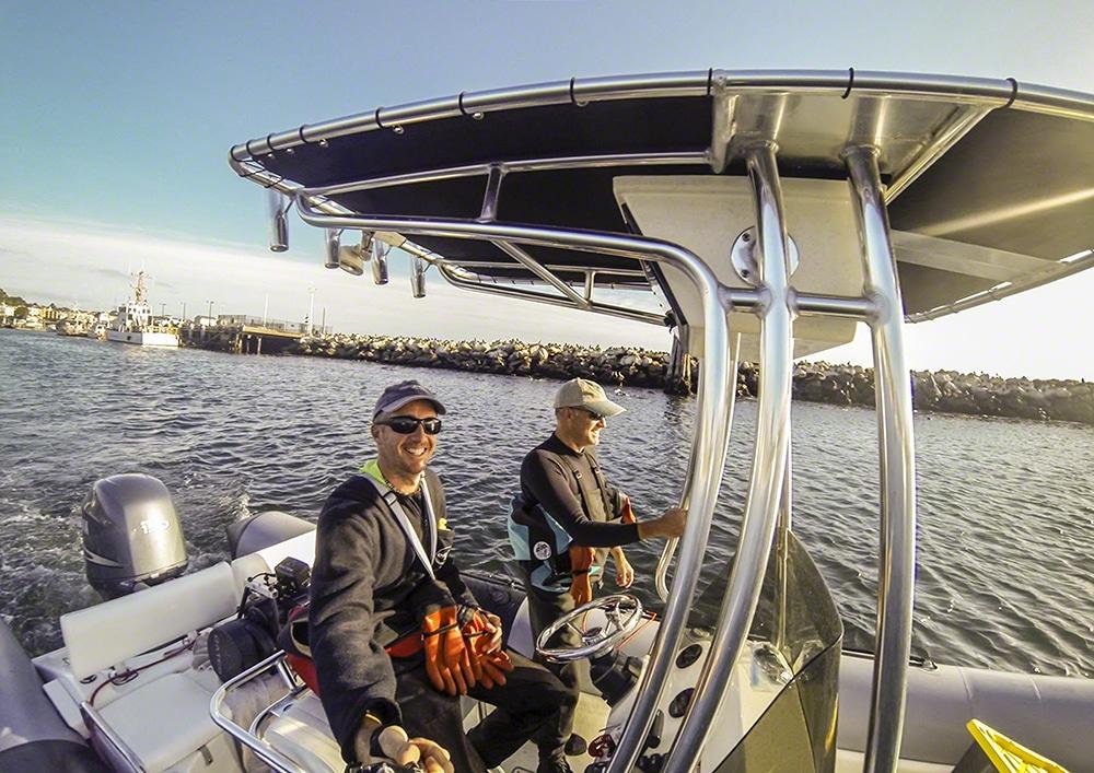 Scuba divers in a zodiac boat in Monterey Harbor, California