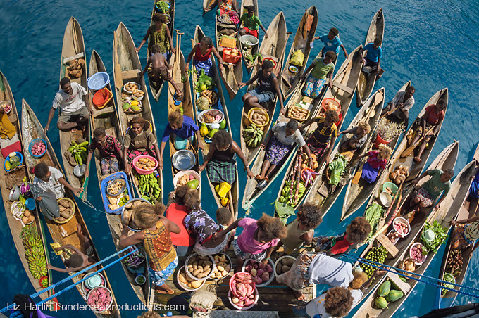 many dugout canoes full of fruits and vegetables, Pacific islanders