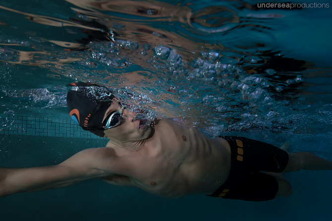 Underwater lifestyle portrait of a male triathlete swimming hard
