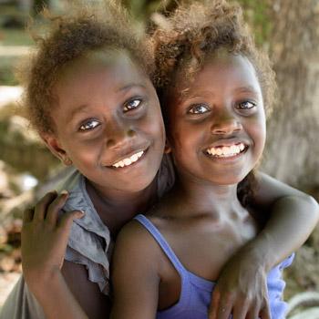 two happy solomon islander children girls smiling